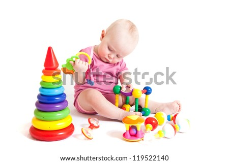 Portrait of cute little girl playing toys. Isolated on white - stock photo