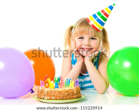 Portrait of cute little girl with birthday cake - stock photo