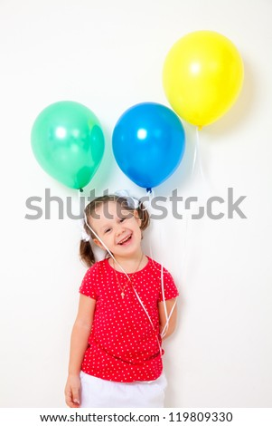 Portrait of cute little girl with bunch of balloons - stock photo