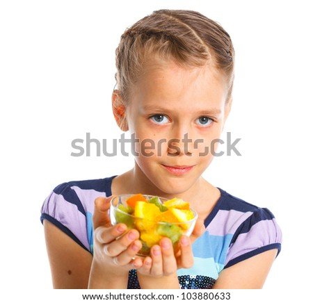 Portrait of cute little girl with fruits. Isolated on a white background