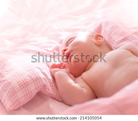 Portrait of cute little sleeping baby, sweet naked newborn girl napping at home, healthy lifestyle, innocence concept - stock photo