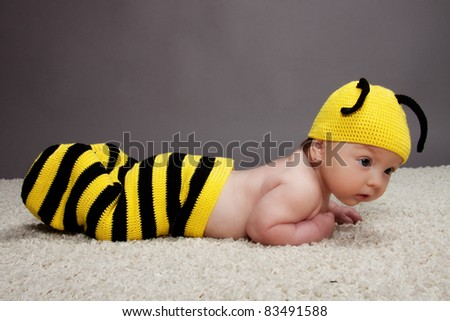 Portrait of cute newborn girl dressed in a bee costume - stock photo