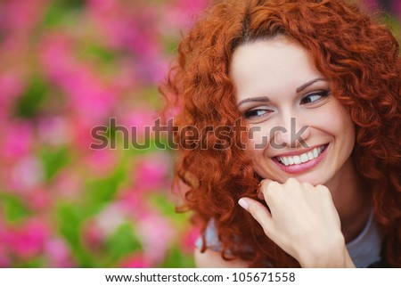 portrait of cute red haired young woman, outdoor - stock photo