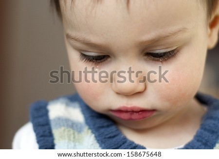 Portrait of cute sad crying toddler child or baby, girl or boy.  - stock photo