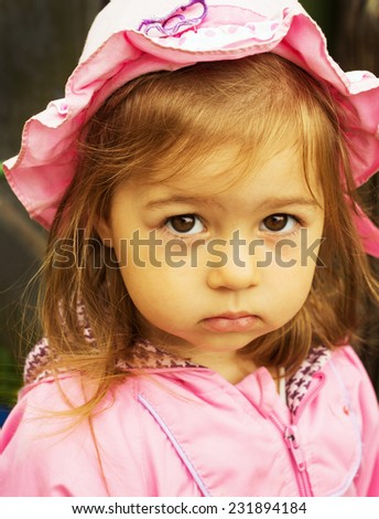 Portrait of cute sad little girl  - stock photo