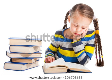 Portrait of cute schoolgirl  attentively reading the book on isolated white background - stock photo