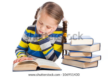 Portrait of cute schoolgirl  attentively reading the book on isolated white background