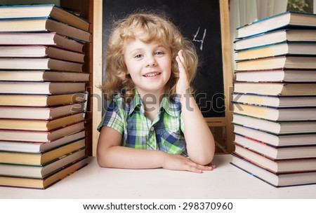 Portrait of cute schoolgirl raising hand knowing the answer to the question - stock photo