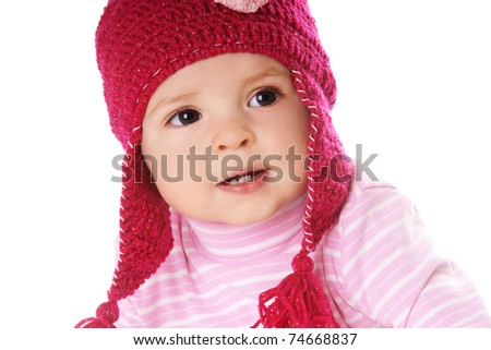 Portrait of cute smiling baby girl in pink hat isolated on white background - stock photo