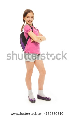Portrait of cute, smiling, confident 9 years old girl with ponytails, wearing rucksack isolated on white full height, side view - stock photo