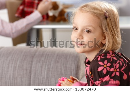 Portrait of cute smiling little girl at home. - stock photo