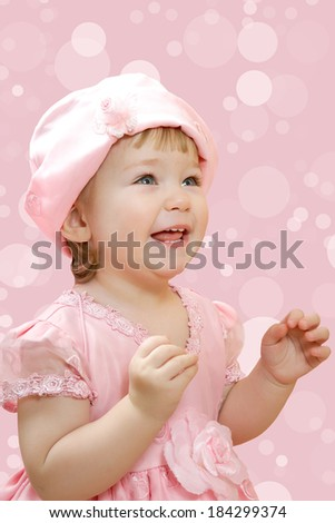 Portrait of cute smiling little girl in pink princess dress