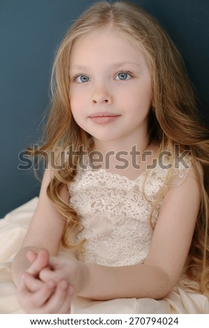 Portrait of cute smiling little girl in princess lace dress - stock photo