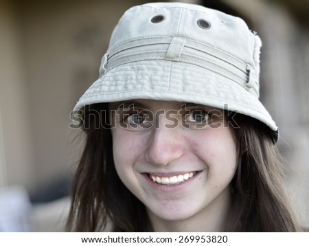 Portrait of Cute Teenage Girl Wearing Hat - stock photo
