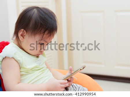 Portrait of cute Thai children with phone - stock photo