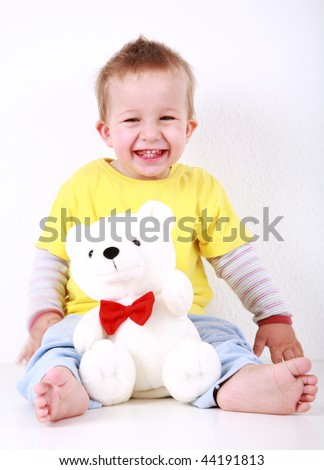 Portrait of cute toddler laughing with toy