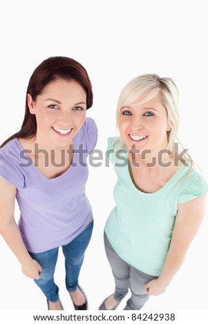 Portrait of cute women posing in a studio
