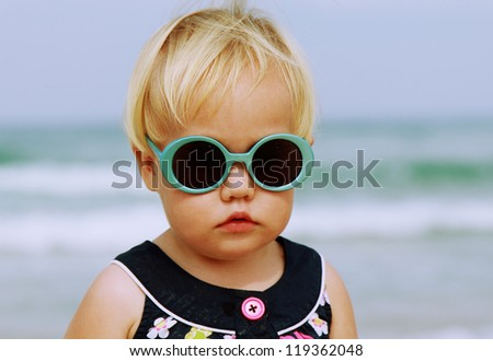 Portrait of cute 1,5 years old baby with fashion vintage sunglasses - stock photo