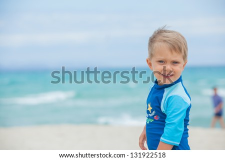 Portrait of cute 2 years old boy have fun on tropical beach - stock photo