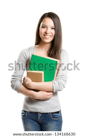 Portrait of cute young brunette student holding exercise books. - stock photo