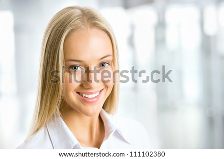 Portrait of cute young business woman - stock photo