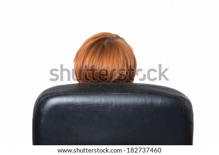 portrait of cute young business woman from behind dreaming, resting on office chair  - stock photo