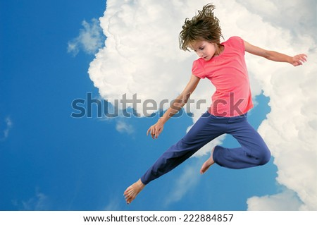 Portrait of cute young dancer girl against blue cloudy sky. Horizontal