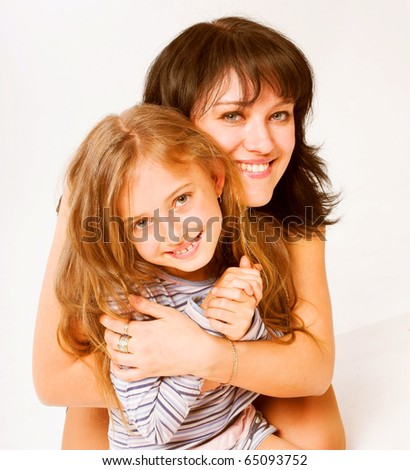 portrait of cute young girl and her mother - stock photo