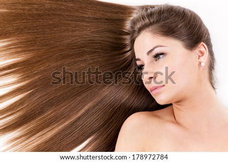 Portrait of Cute young girl with Beautiful healthy shiny hair.