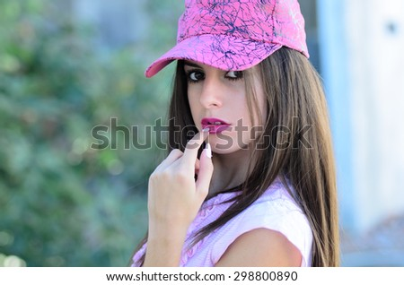 Portrait of cute young lady with pink hat and shirt