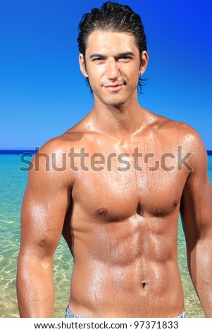 Portrait of cute young man on the beach