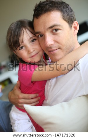 Portrait of daddy with little girl - stock photo