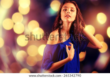 Portrait of dancing girl on the club party. - stock photo