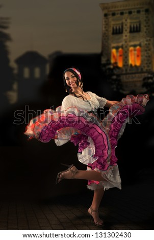 Portrait of dancing Gypsy girl with Andalusian landscape - stock photo