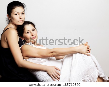 Portrait of daughter and her mother - stock photo