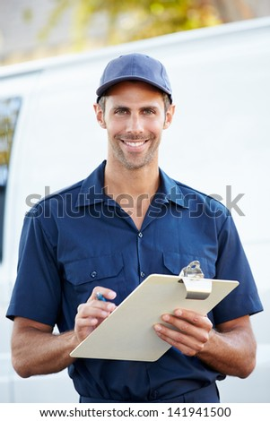 Portrait Of Delivery Driver With Clipboard