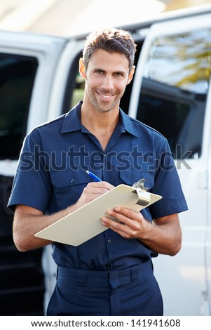 Portrait Of Delivery Driver With Clipboard - stock photo