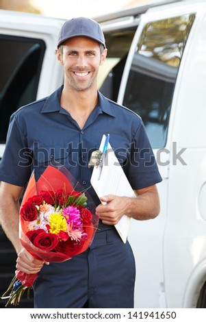 Portrait Of Delivery Driver With Flowers - stock photo