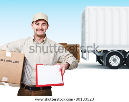 portrait of delivery man and truck background - stock photo