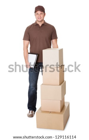 Portrait of delivery man doing paperwork. Isolated on white background