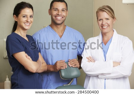 Portrait Of Dentist And Dental Nurses In Surgery - stock photo