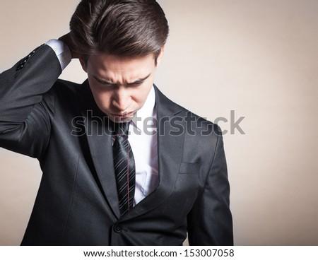 Portrait of depressed, sad man - stock photo