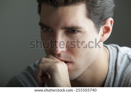portrait of depressed young man - stock photo