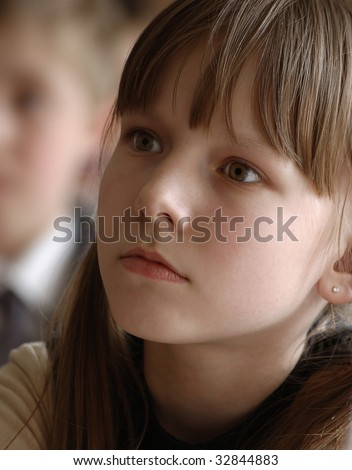 portrait of despondent girl on brown background