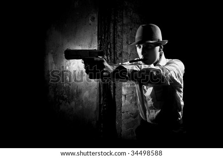 portrait of detective with pistol - stock photo