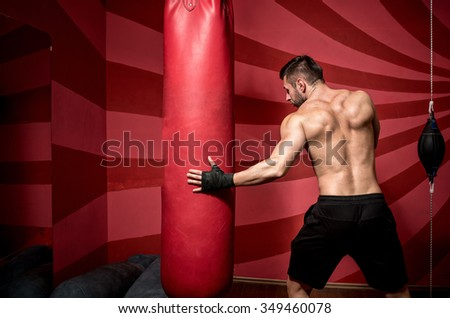 portrait of determined professional boxer, getting ready for fight, training and practicing - stock photo
