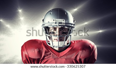 Portrait of determined sportsman against spotlights