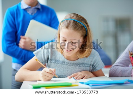 Portrait of diligent pupil drawing at lesson - stock photo
