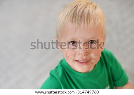 Portrait of dirty little boy
