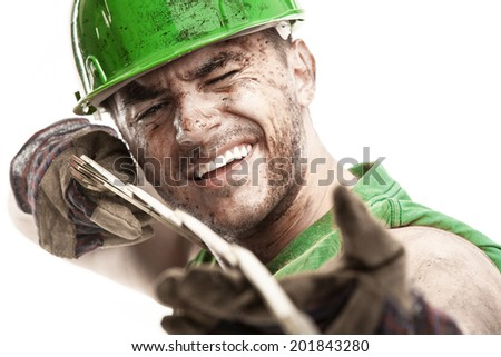 portrait of dirty worker with helmet measuring with classic wood meter isolated on white background - stock photo